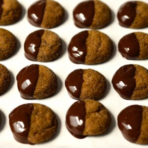 chocolate covered gingersnaps on parchment paper