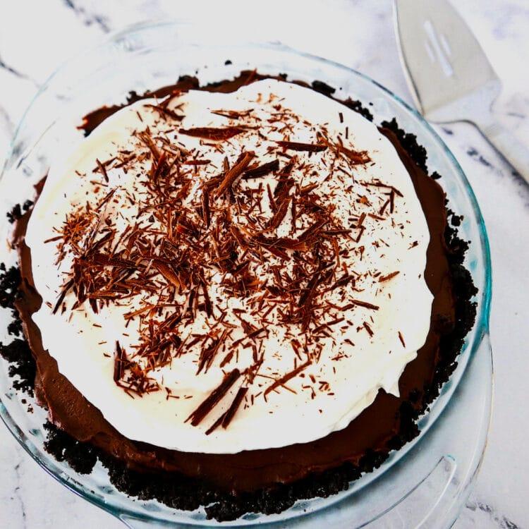 chocolate cream pie in a glass pie pan