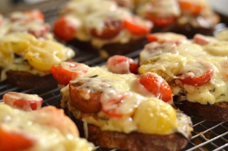 croque veggie with roasted tomatoes on a cooling rack