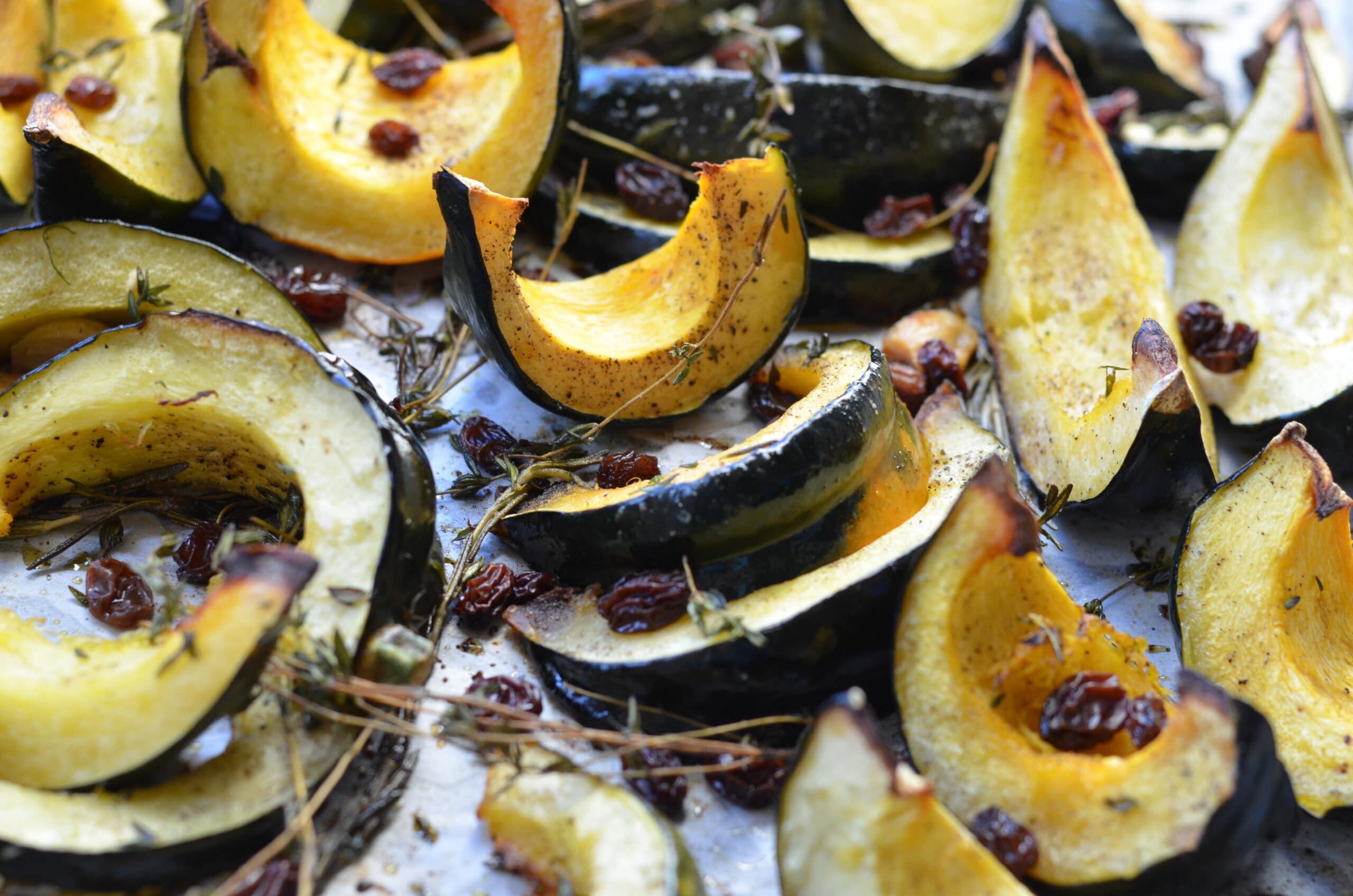 roasted acorn squash on a baking sheet