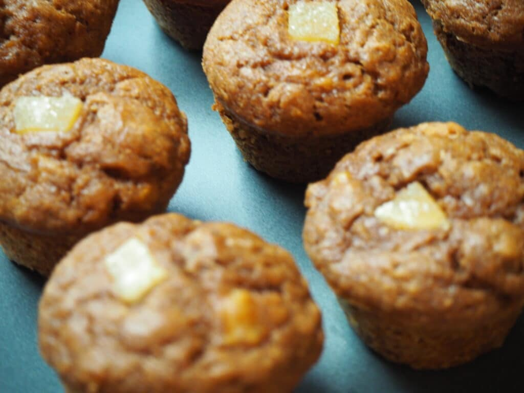 healthy gingerbread muffins arranged on a blue platter