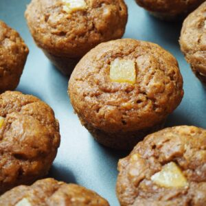 nine healthy gingerbread muffins lined up on a blue plate