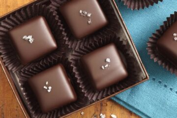 sea salt caramels in a gift box with a blue napkin next to box