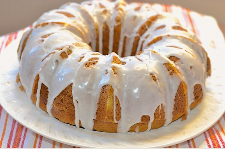 pumpkin spice bundt cake on a white platter
