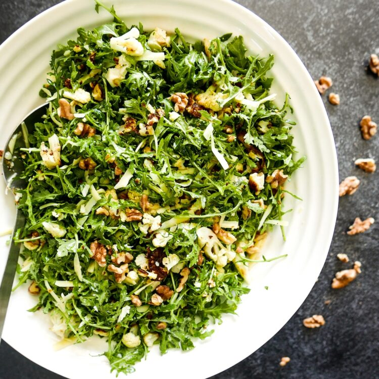 roasted cauliflower salad in a large white bowl
