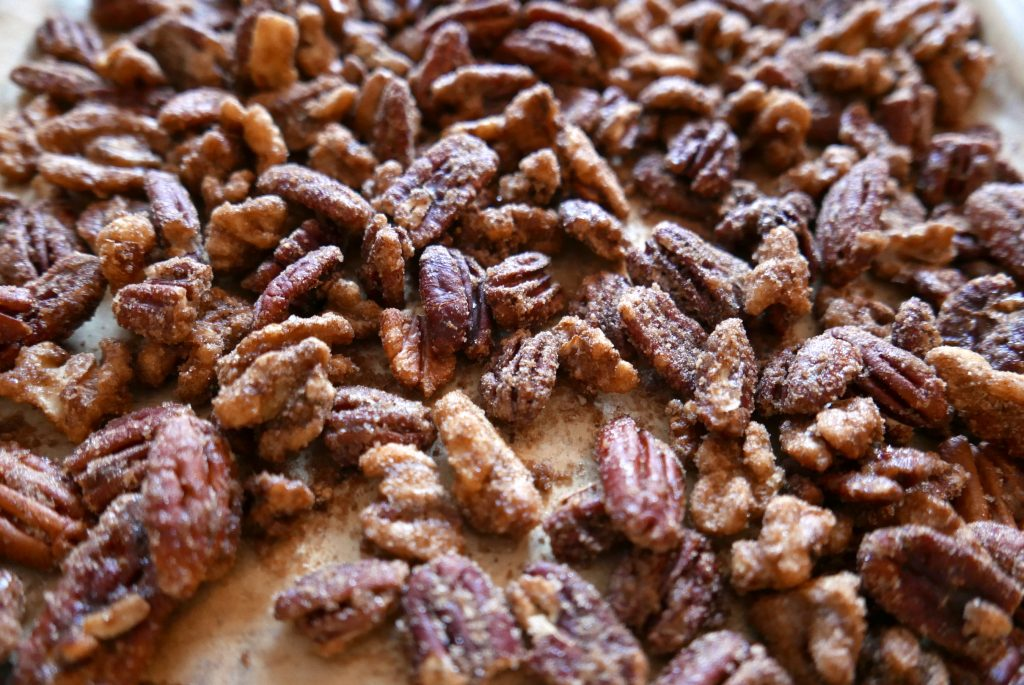 candied mixed nuts arranged on a baking sheet