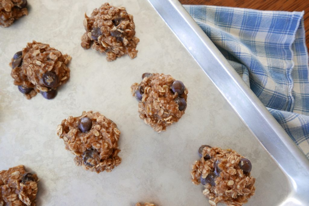 healthy banana peanut butter oatmeal cookies on a baking sheet