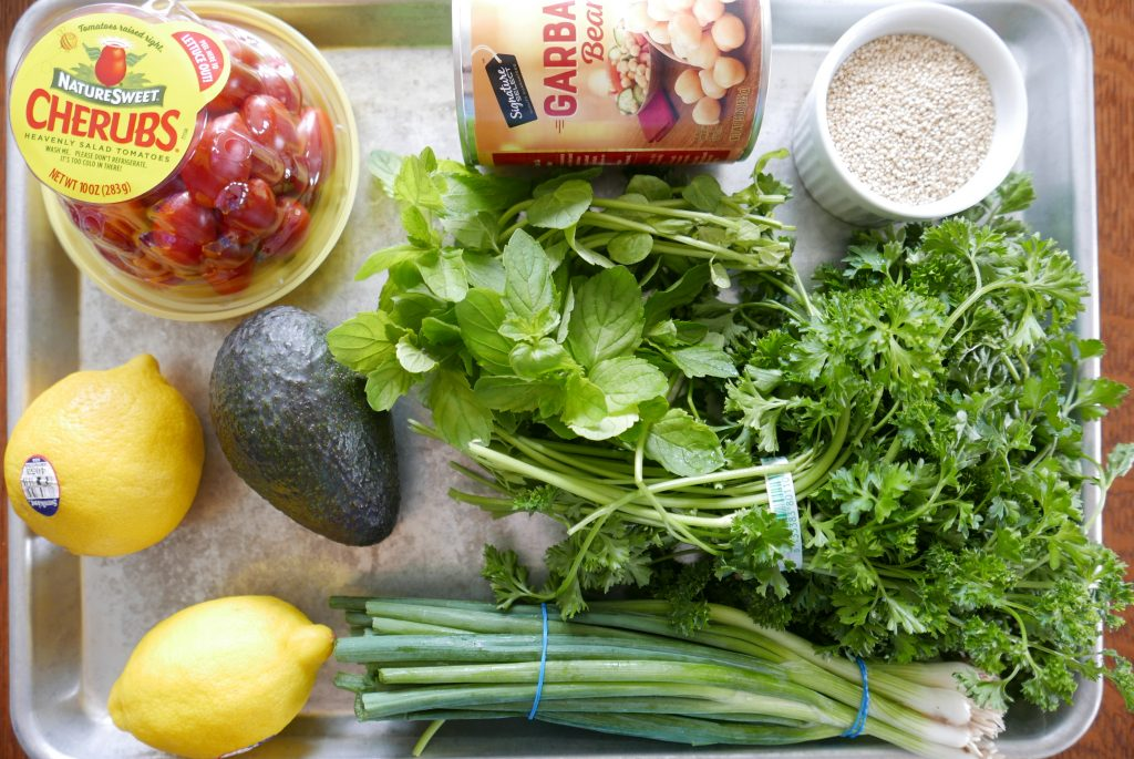 ingredients for tabbouleh salad arranged on a baking sheet