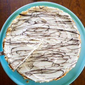 no bake tahini cheesecake on blue platter