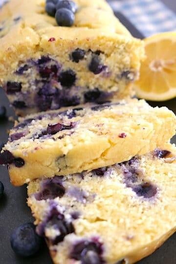 blueberry lemon ricotta pound cake sliced on a stone platter