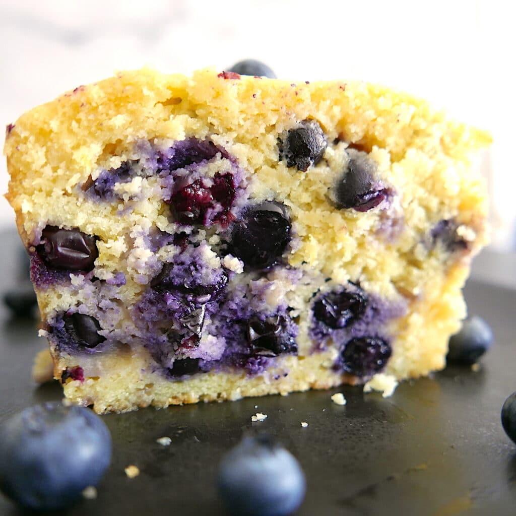 close up of blueberry lemon ricotta pound cake slice