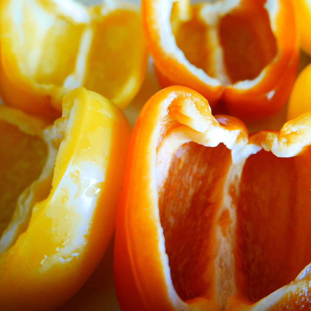 hollowed out orange and yellow bell peppers in a casserole dish