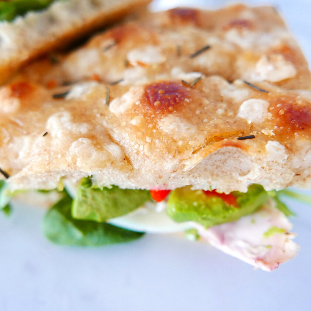 close up of rosemary garlic focaccia sandwich