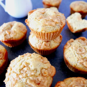 almond poppy seed muffins with almond paste streusel arranged in a formation on a marble table