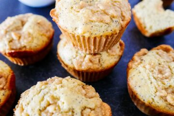almond poppy seed muffins with almond paste streusel arranged on table