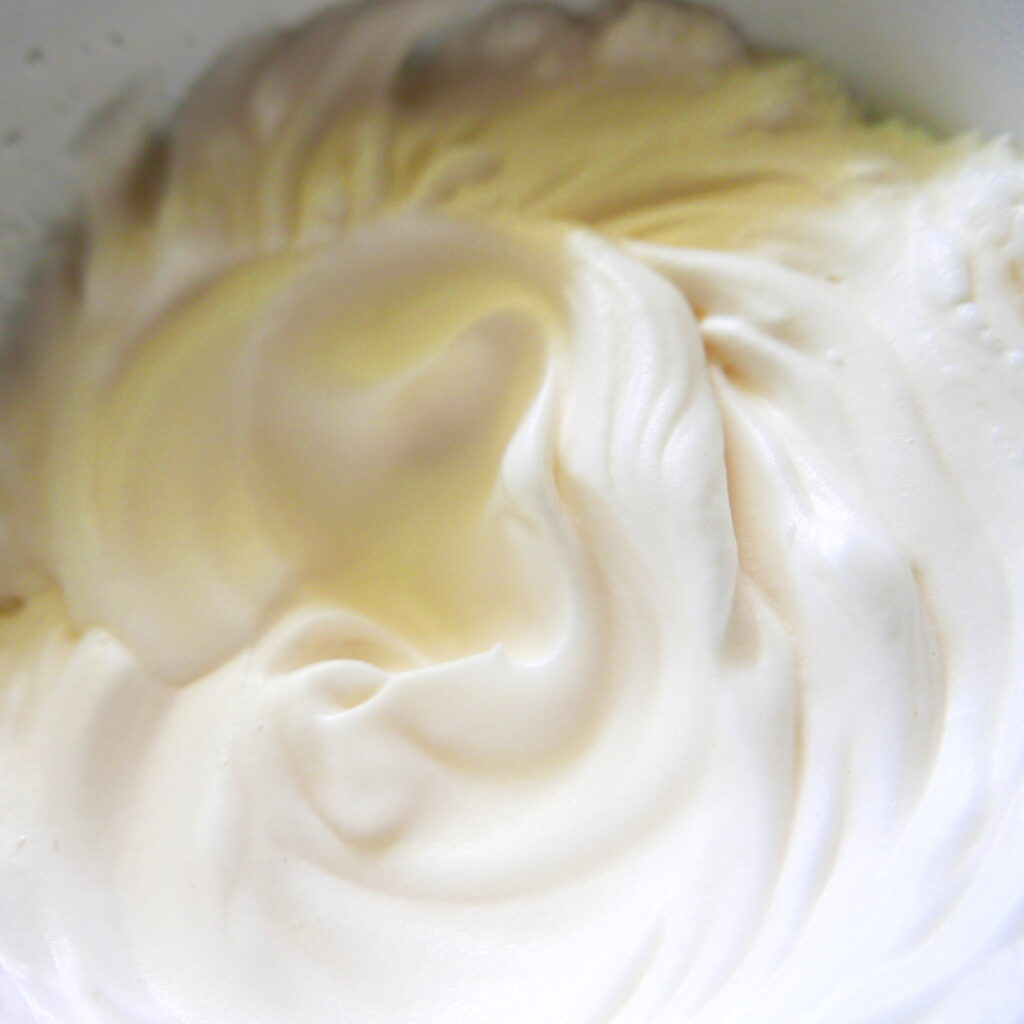 egg white meringue in a mixing bowl