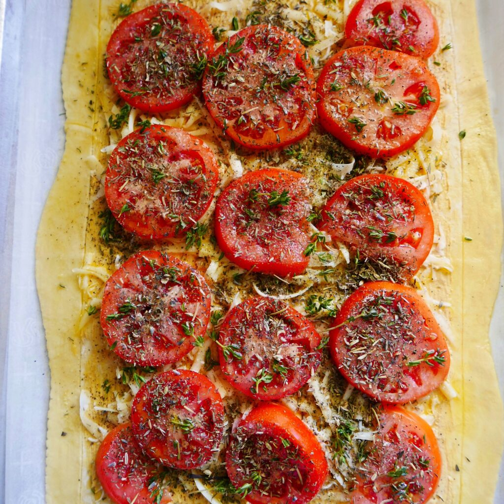 tomato, gruyere, and mustard tart prepped for the oven
