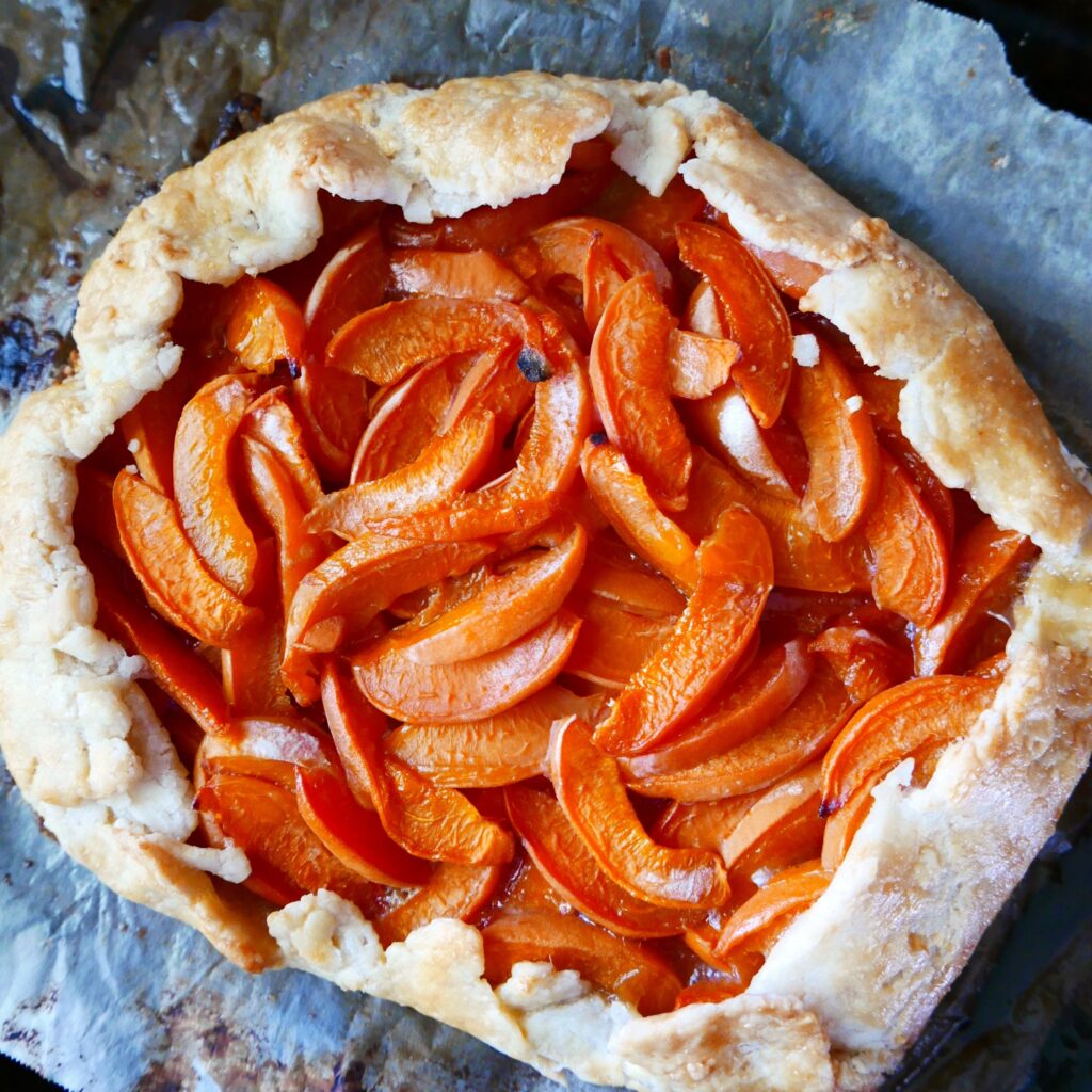 apricot gluten free galette cooling on a baking sheet