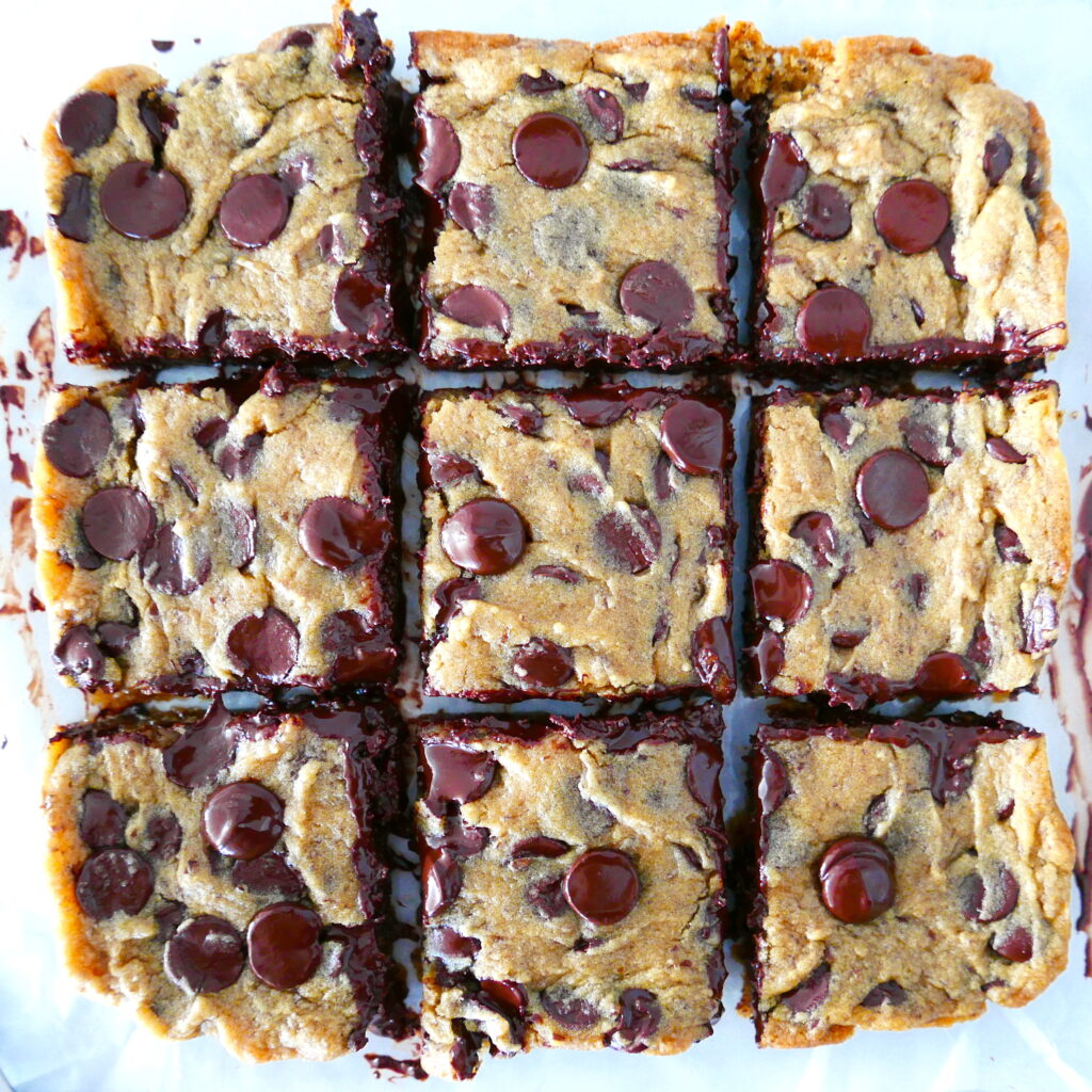 melty and gooey vegan blondies cut into a grid pattern