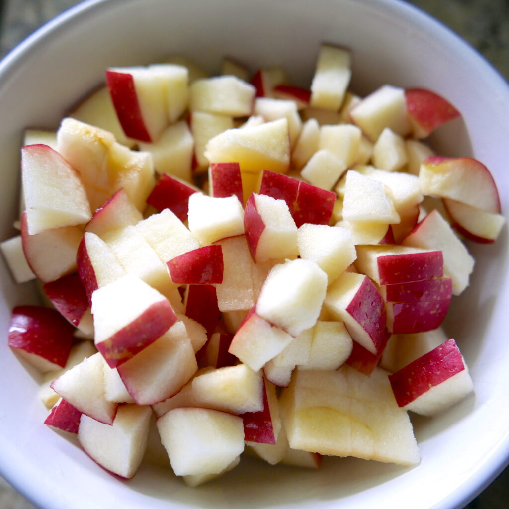 diced apples in a white bowl