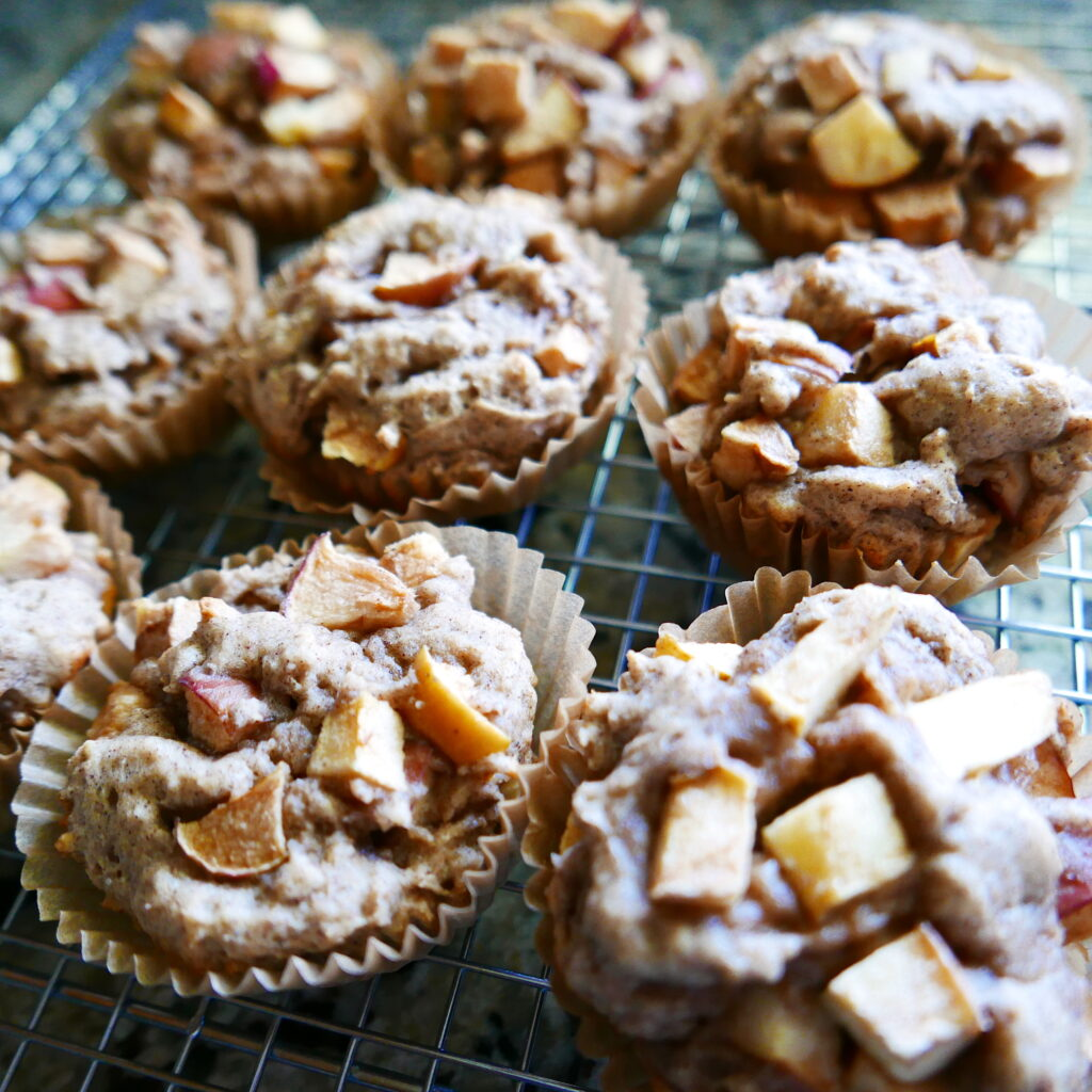 chunky gluten free apple muffins cooling on a wire rack