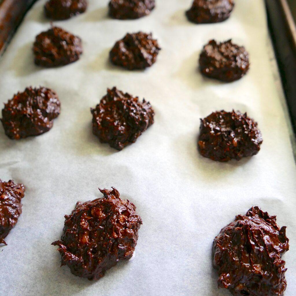 peanut butter fudge cookies arranged on a baking sheet