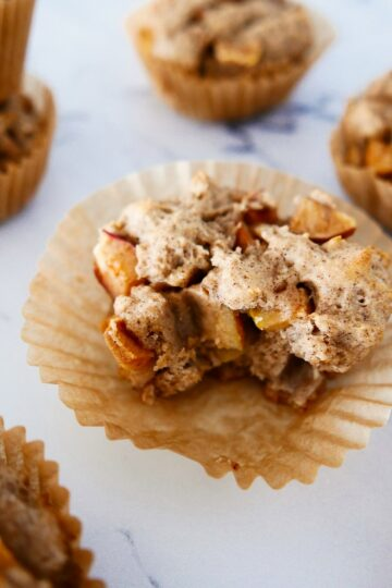 chunky gluten free apple muffins arranged on white marble