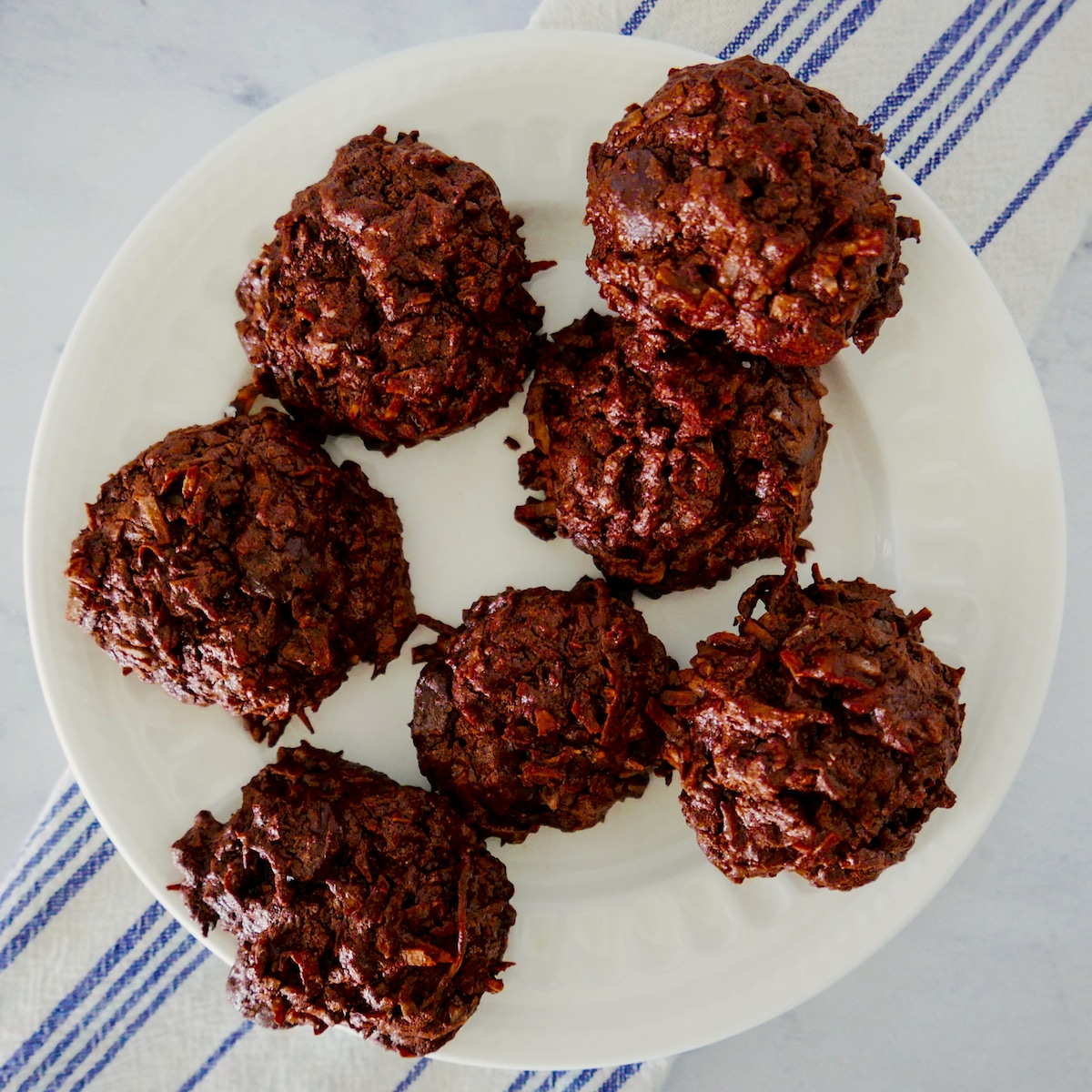 coconut macaroons with chocolate chips on a white plate