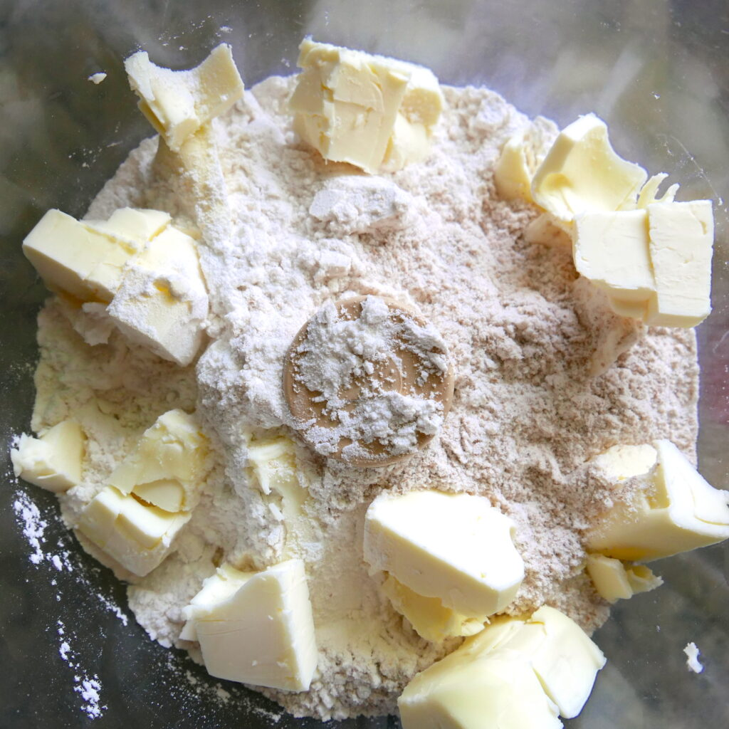cubed butter and flour in a food processor