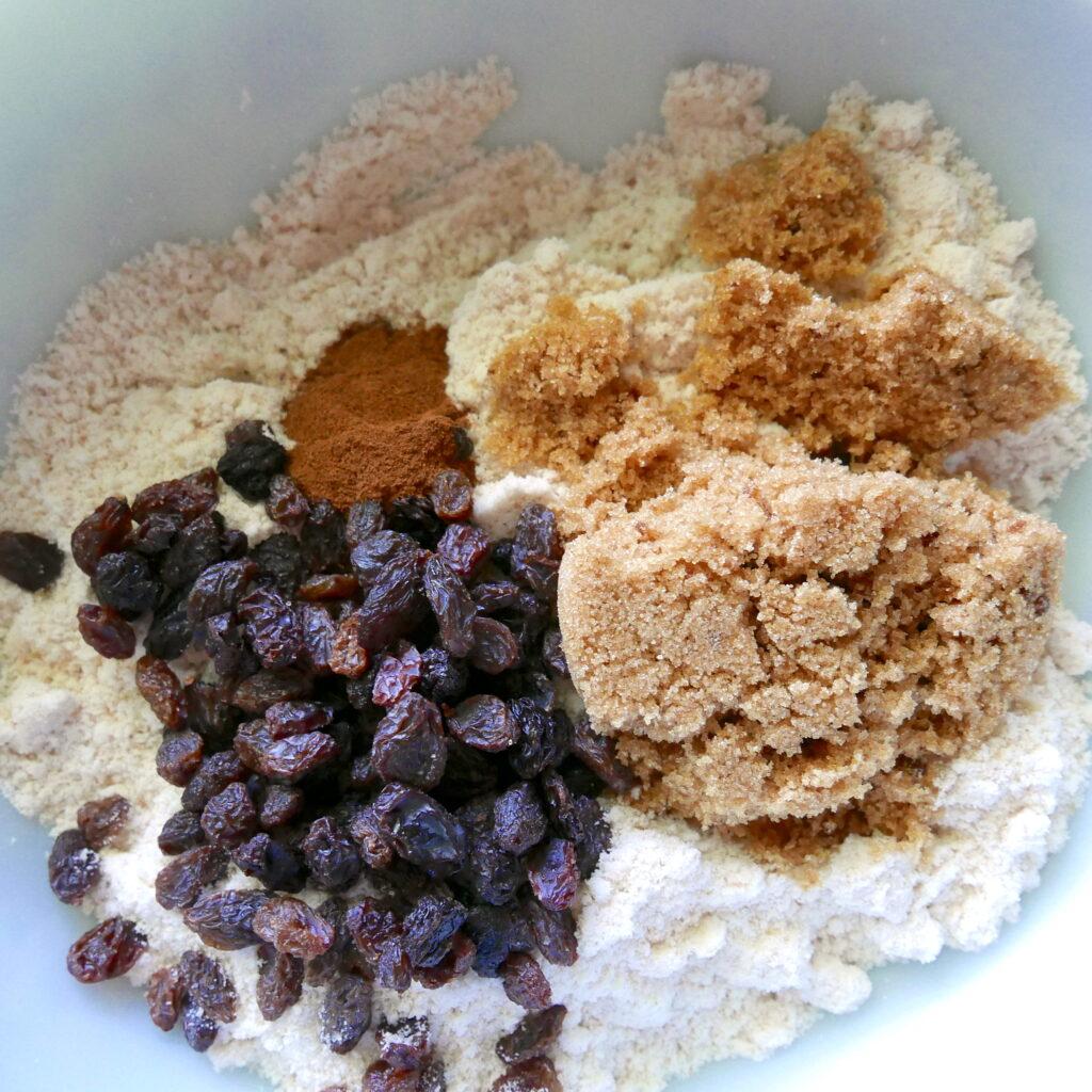brown sugar, raisins, and flour in a mixing bowl