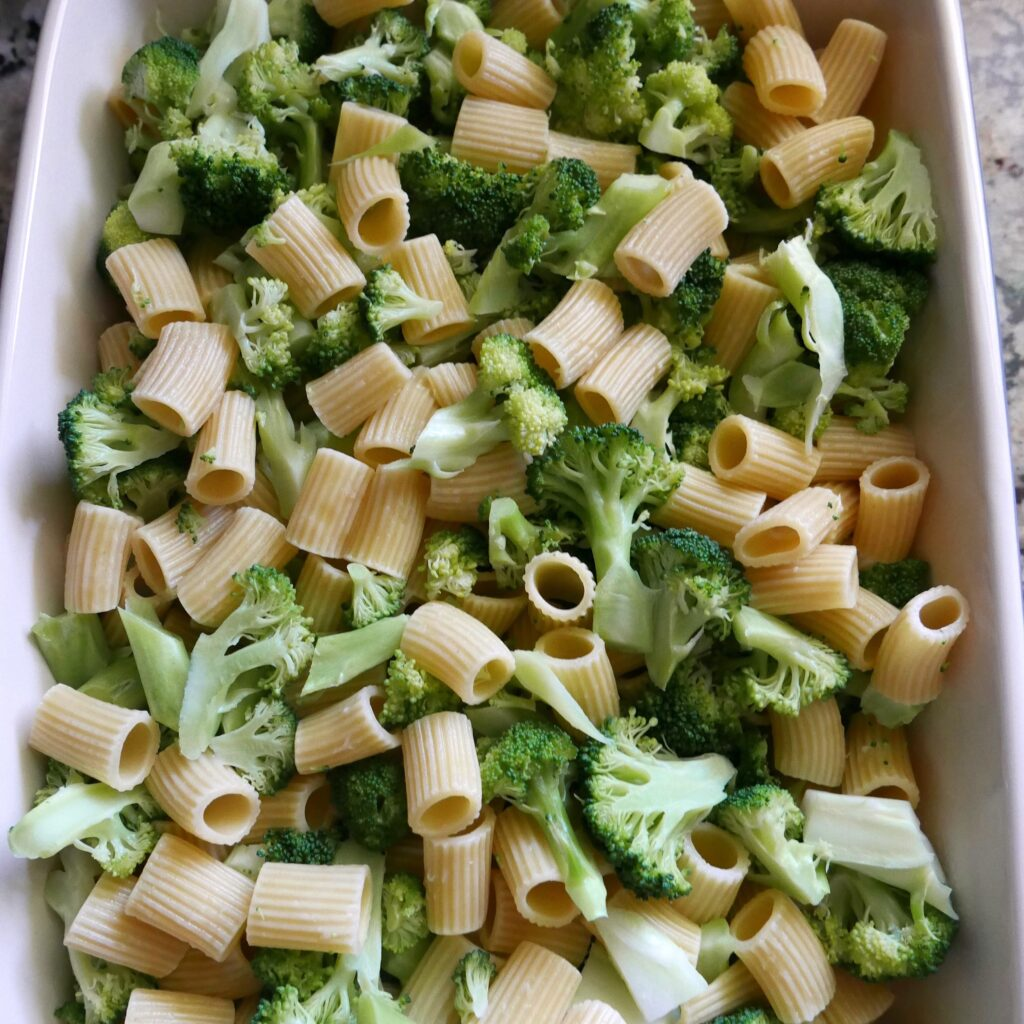 broccoli and noodles in a baking pan