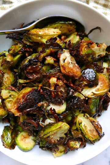 roasted brussel sprouts with garlic in a white bowl