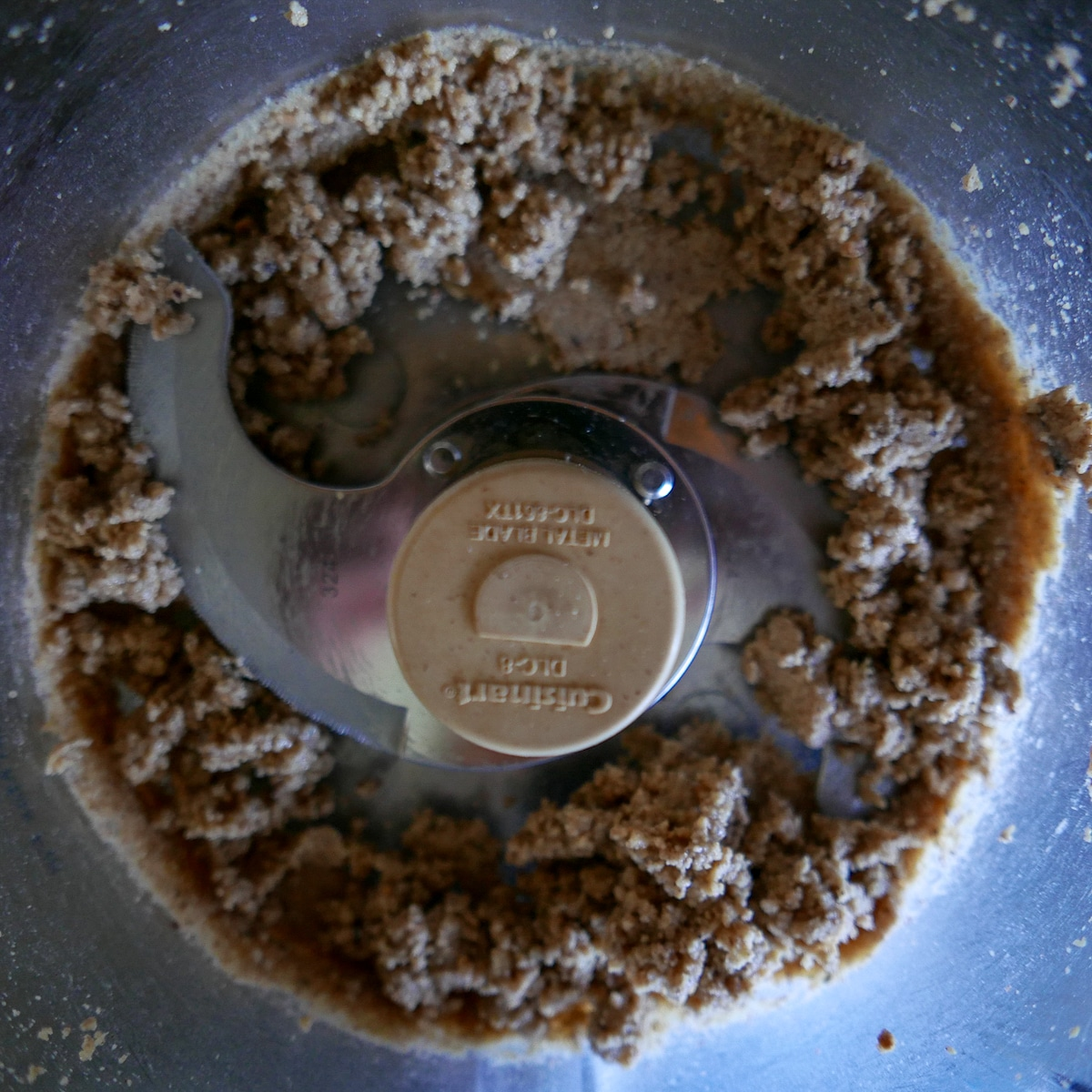 hazelnuts and cocoa powder in food processor