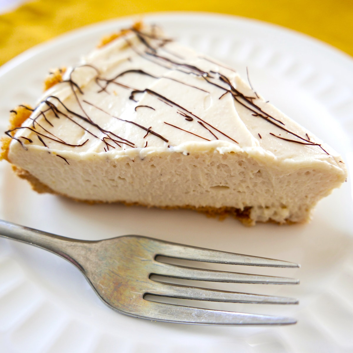 slice of tahini cheesecake on plate with fork