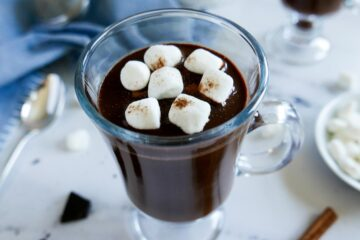 oat milk hot chocolate in a mug garnished with marshmallows