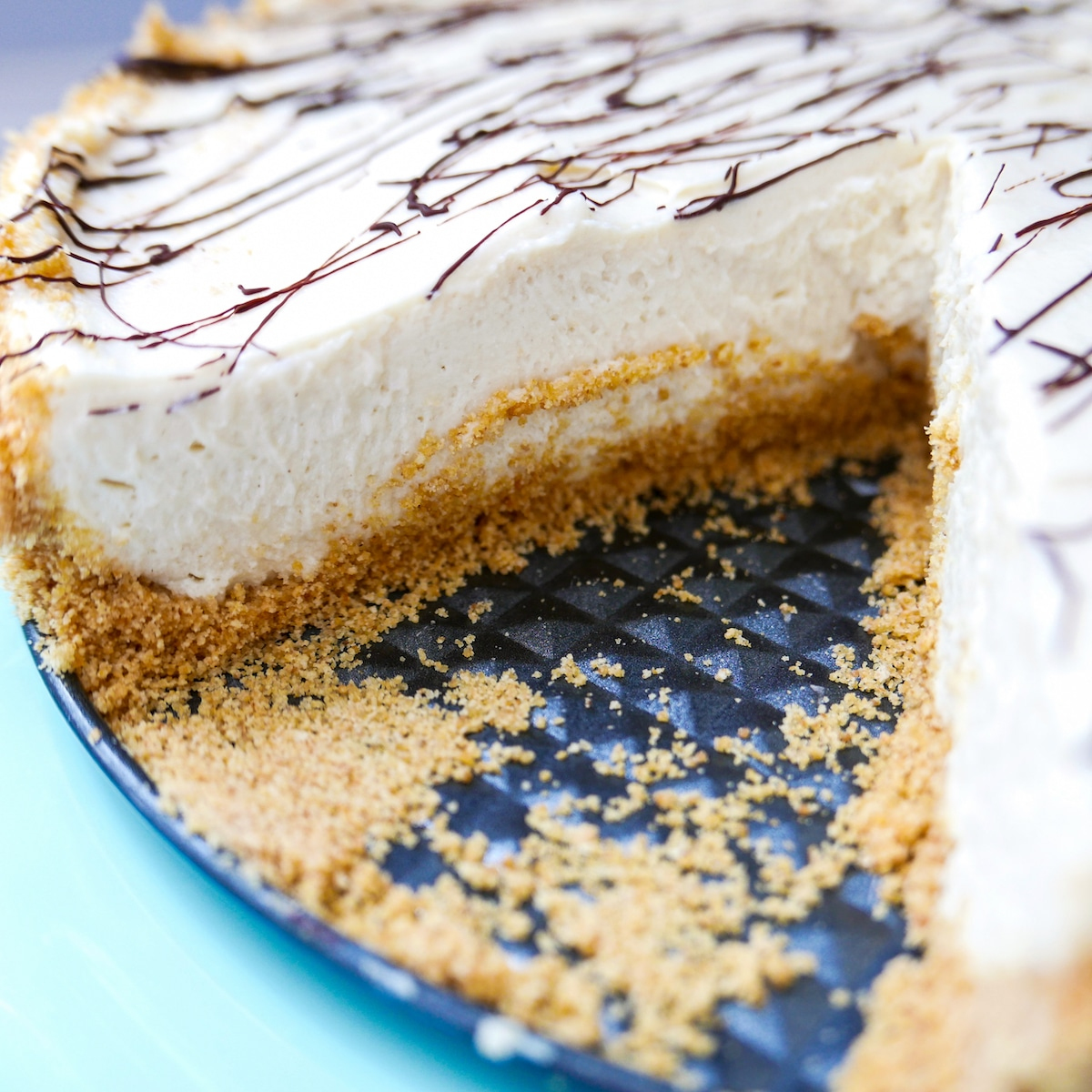 tahini cheesecake with slice cut out of it