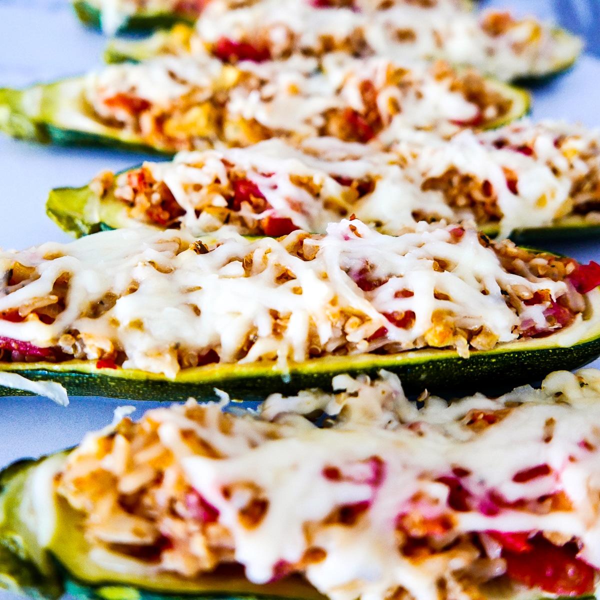 rice stuffed zucchini boats topped with mozzarella