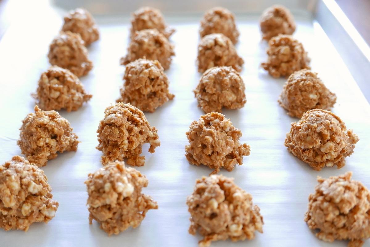rice krispie balls on baking sheet